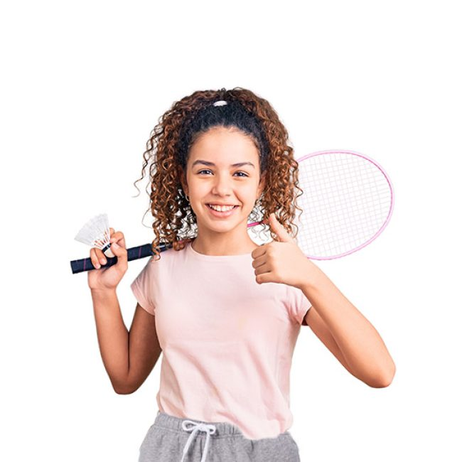 Beautiful kid girl with curly hair holding badminton racket and shuttlecock smiling happy and positive, thumb up doing excellent and approval sign